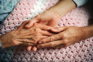 holding hands with an elderly woman