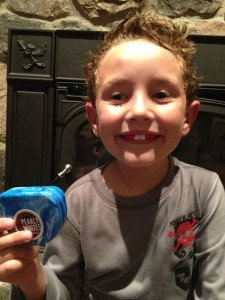 happy little boy showing off his new mouth guard for hockey